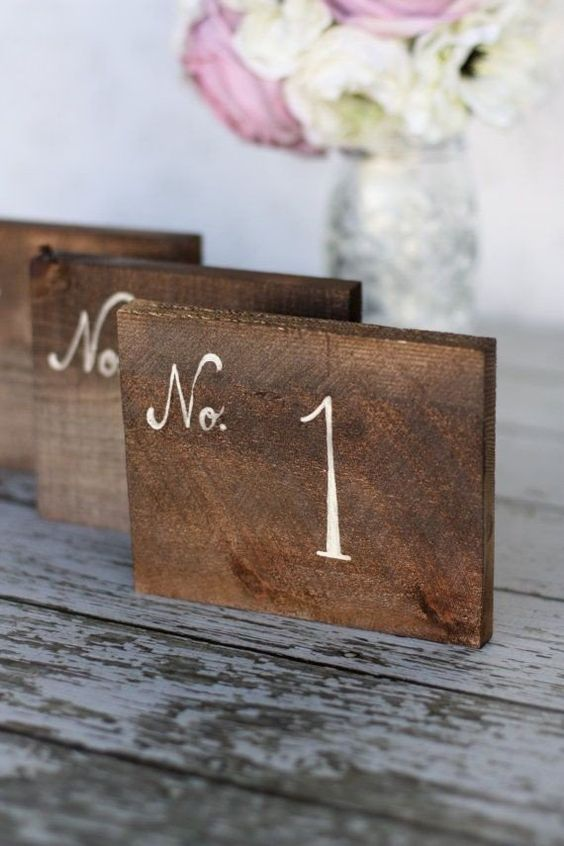 rustic table numbers. rustic outdoor wedding ideas that are unique. Rustic wedding decoration ideas. Rustic decorations on a budget. Rustic wedding planning ideas. Rustic decorations for a wedding. Cheap rustic wedding ideas. Outdoor wedding ideas on a budget. DIY outdoor wedding ideas. #rusticwedding
