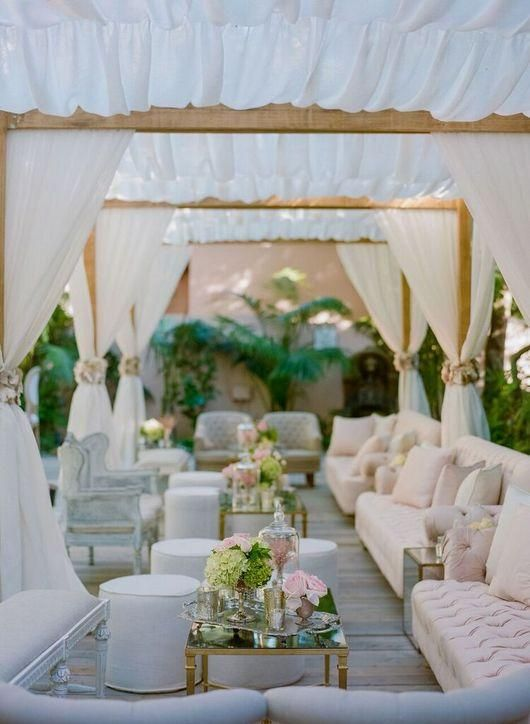 Outdoor wedding lounge area. Are you looking for low budget wedding ideas for your reception? Then you might want to read this. We have come up with a way for you to save lots of money when planning a wedding on a budget. If you are a DIY Bride and you are looking for affordable wedding ideas, be sure to check out our budget-friendly tips. Enjoy our DIY low budget wedding ideas #budgetwedding #weddingideas #weddingplanning