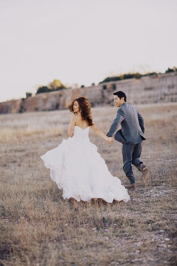 Wedding photos that are fun make for the best wedding photo. Check out this wedding photo idea when a couple is running away! #weddingideas #weddingphotos