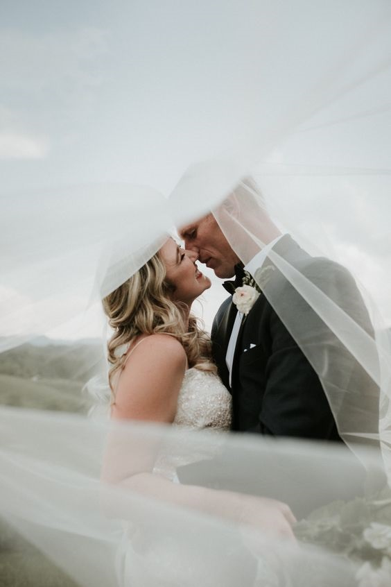 Under the veil wedding shot. This is a romantic wedding photo idea that you can use on your own big day!