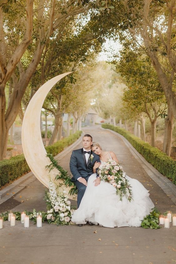 Celestial themed wedding inspiration, moon and star wedding ideas, Life-size moon backdrop photo prop, fairytale wedding at a castle. #celestialwedding #fairytalewedding, #moonwedding #weddingtheme #weddingideas #castlewedding #weddinginspiration #weddingdetails #weddinginspo